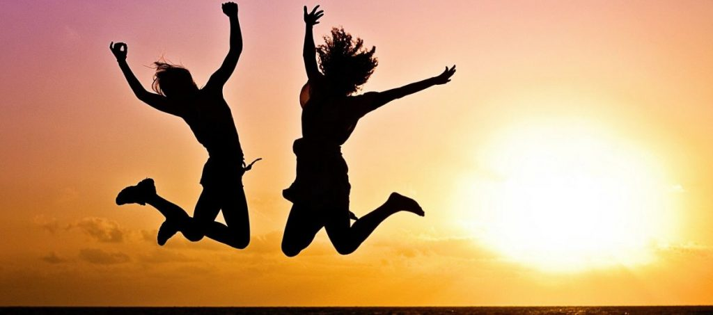 eQuantum system happy women jumping